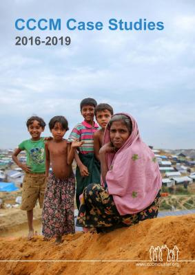Cover Page - CCCM Case Studies 2016 - 2019. Four children stand smiling behind a woman seated on a hill. They are in Cox's Bazar